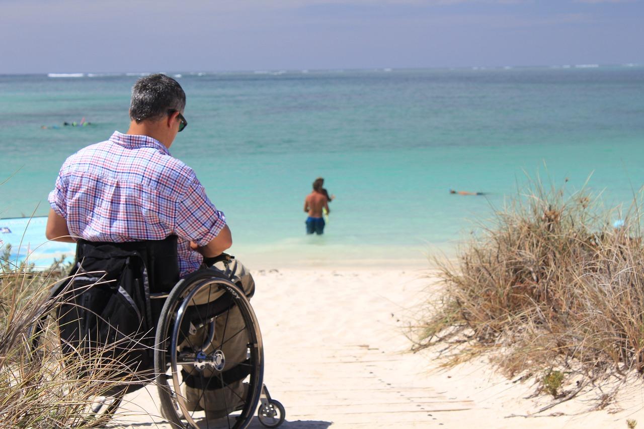 man at the beach in a wheelchair